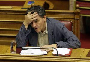 4685606_6_fe10_le-ministre-des-finances-grec-euclide_f1e6b215109ecc773dbbe6e21feb0cd5
