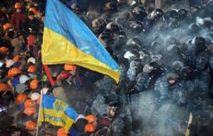 "TOPSHOTS Riot policemen clash with protesters on Independence Square in Kiev, on December 11, 2013. Ukrainian security forces on December 11 stormed Kiev's Independence Square which protesters have occupied for over a week but the demonstrators defiantly refused to leave and resisted the police in a tense standoff. Eite Berkut anti-riot police and interior ministry special forces moved against the protestors at around 2:00 am (midnight GMT) in a move that prompted US Secretary of State John Kerry to express ""disgust"" over the crackdown.   AFP PHOTO/ SERGEI SUPINSKY"