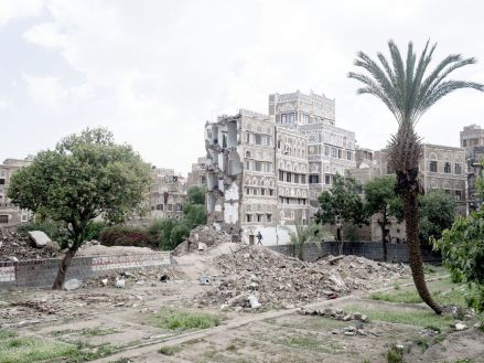 YEMEN. Sanaa. 7 September 2015. The aftermath of an airstrike carried out by the Saudi Arabian-led coalition that destroyed a building in the old city and killed 6 civilians. The old city was declared a World Heritage Site by the United Nations in 1986. The buildings are more than 1,400 years old.