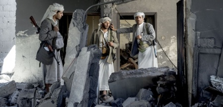 YEMEN. Sanaa. 8 September 2015. Mathbah district. A group of fighters loyal to Sheik Ali Aiyedh inside his destroyed house.
