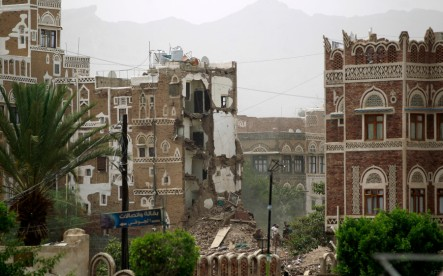 Houses in the UNESCO-listed heritage site in the old city of Yemeni capital Sanaa, are seeing destroyed on June 12, 2015 following an overnight Saudi-led air strike. Residents said the pre-dawn strike, which killed five people was the first direct hit on old Sanaa since the launch of the bombing campaign against Huthi rebels in late March. AFP PHOTO / MOHAMMED HUWAIS
