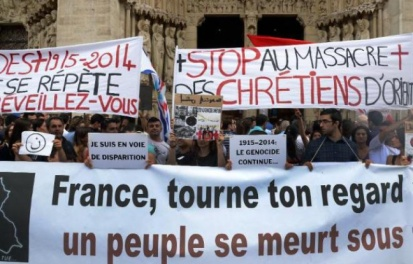 648x415_rassemblement-soutien-chretiens-orient-parvis-cathedrale-paris-27-juillet-2014