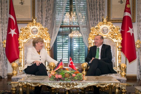 ISTANBUL, TURKEY - OCTOBER 18: In this handout photo provided by the German Government Press Office (BPA), German Chancellor Angela Merkel and Turkish President Recep Tayyip Erdogan talk at the start of their meeting at the Yildiz Palace on October 18, 2015 in Istanbul, Turkey. Merkel also met Turkish Prime Minister Ahmet Davutoglu earlier today. (Photo by Guido Bergmann/Bundesregierung via Getty Images)
