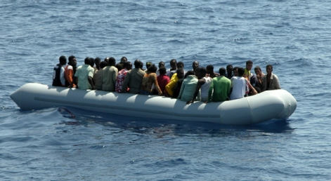 A zodiac with 29 illegal male and 19 female Somalian immigrants is seen after being intercepted by the Italian Coast Guard, 35 miles off Lampedusa island, south of Italy, 15 August 2007. During the last two days 14 illegal immigrant died at sea after their zodiac went down, according to Italian authorities. AFP PHOTO / MAURICIO ESSE