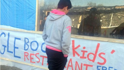 In this photo taken on Friday, April 15, 2016, 13-year-old Imran, his nickname, an unaccompanied minor from Laghman in Afghanistan, leaves the Jungle Book Restaurant for Kids, set up by volunteers on the main passageway through the makeshift migrant camp in Calais in northern France. Imran, who says he has been at the squalid camp for five months, tries most nights to jump into a truck hauling freight across the English Channel to join his uncle in Britain. All across Europe, there is a growing shadow population of thousands of under-age migrants who are living on their own, without families. They hide silently and in plain sight, rarely noticed in the crowd. Nobody even knows how many of them there are -- Europol estimates broadly that at least 10,000 kids have gone missing from shelters or reception centers. (AP Photo/Elaine Ganley)/ASIA314/16139427127258/PICTURE MADE AVAILABLE Friday, April 15, 2016/1605181416