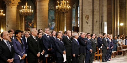 "French President Francois Hollande (C) stands next to (from R) French Prime Minister Manuel Valls, French Senate speaker Gerard Larcher, French National Assembly speaker Claude Bartolone, former French President Valery Giscard d'Estaing, head of France's Les Republicains political party and former French president, Nicolas Sarkozy, and French Foreign Minister Jean-Marc Ayrault, Education Minister Najat Vallaud-Belkacem and Interior Minister Bernard Cazeneuve attend a mass at the Notre Dame Cathedral in Paris on July 27, 2016 to pay tribute to the priest Jacques Hamel, killed on July 26 in his church of Saint Etienne du Rouvray during a hostage-taking claimed by Islamic State group. France probes an attack on a church in which two men described by the Islamic State group as its ""soldiers"" slit the throat of a priest. An elderly priest had his throat slit in a church in northern France on July 26 after two men stormed the building and took hostages. The attack in the Normandy town of Saint-Etienne-du-Rouvray came as France was still coming to terms with the Bastille Day killings in Nice claimed by the Islamic State group. / AFP PHOTO / POOL / BENOIT TESSIER"