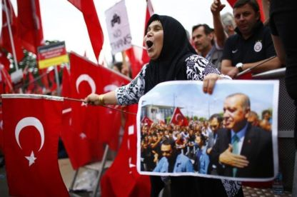 898015-supporters-of-turkish-president-erdogan-wave-turkish-flags-during-a-pro-government-protest-in-cologn