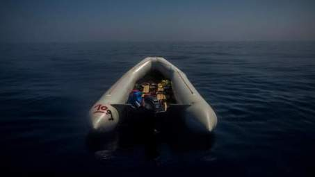 In this photo taken on Saturday Sept. 10, 2016, a rubber boat used by refugees to leave Libya drifts abandoned after a rescue operation on the Mediterranean sea, about 13 miles north of Sabratha, Libya. (AP Photo/Santi Palacios)